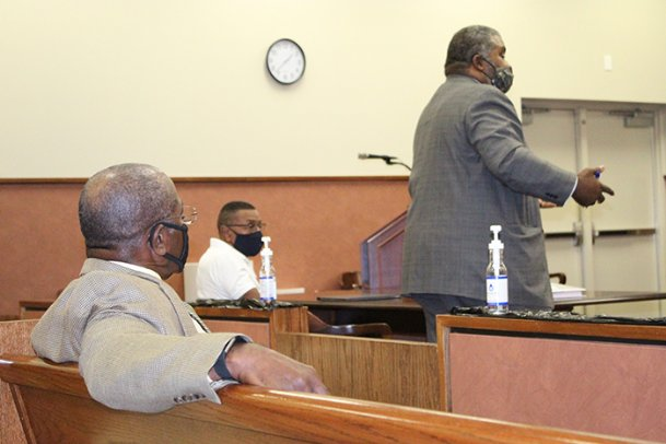 Charles Ware, left, listens to defense attorney Warren Conway, right, present his case for Donald Crowther, center, owner of TCM Construction, on Thursday in Oktibbeha County Circuit Court. Crowther pleaded guilty in July to a fraud charge for submitting false invoices that were reported to the Second Baptist Church trustees, for which Ware is an adviser and spokesman. Judge Lee Coleman ruled Crowther must pay restitution to the church, and Crowther will be sentenced further Nov. 2.