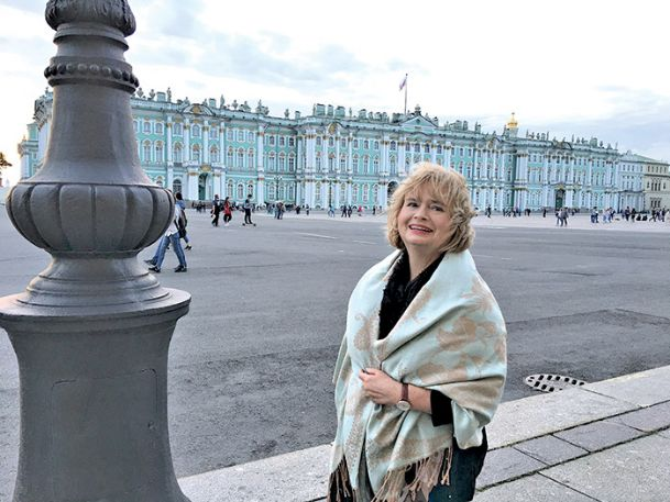 Margaret Mary Henry of Columbus, world languages teacher at the Mississippi School for Mathematics and Science, is pictured in Palace Square in St. Petersburg, Russia. Behind her is the Winter Palace, now the Hermitage Museum.