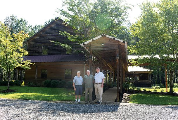 From left, Oktibbeha County Master Gardeners President Chuck Rivenburgh, Catch-A-Dream Foundation CEO Marty Brunson and Master Gardener Ed Williams are pictured in front of the Catch-A-Dream visitor center in Oktibbeha County Thursday. The Master Gardeners group took on landscaping and maintenance of grounds at the national headquarters on Ennis Road, where outdoor adventure wishes are fulfilled for children with life-threatening or terminal illnesses.