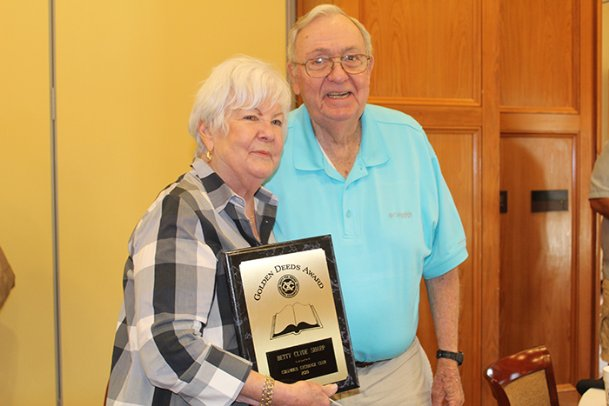 Betty Clyde Sharp poses with her husband Howard Sharp after winning the Columbus Exchange Club's annual Book of Golden Deeds Award at the club's weekly luncheon at Lion Hills Center on Thursday. The club gives the award to an individual who volunteers in the community. Betty Clyde has volunteered with numerous organizations in Columbus in the 60 years she's lived there, including the Exchange Club, Junior Auxiliary, Loaves and Fishes and Camp Rising Sun.