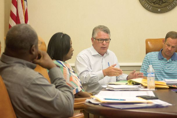 Oktibbeha County Board of Supervisors Attorney Rob Roberson talks during Monday's meeting. The board voted to resolve an issue with bridge panels that were given to Walt Starr in 2017.