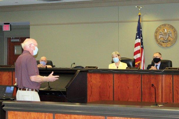 Former Starkville alderman Emmett Smitherman, left, encourages the board Tuesday to
