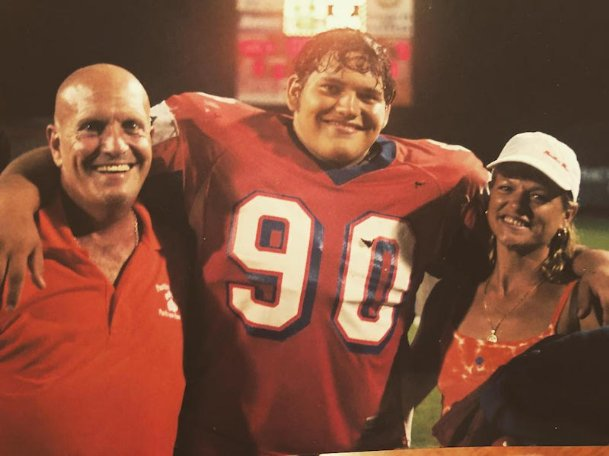 J.C. Brignone, center, poses with his father Julio, left, and his mother Lee during his high school career at Parkview High School in Lilburn, Georgia. Brignone was a junior at St. Stanislaus High School in Pass Christian when Hurricane Katrina destroyed his family's house.