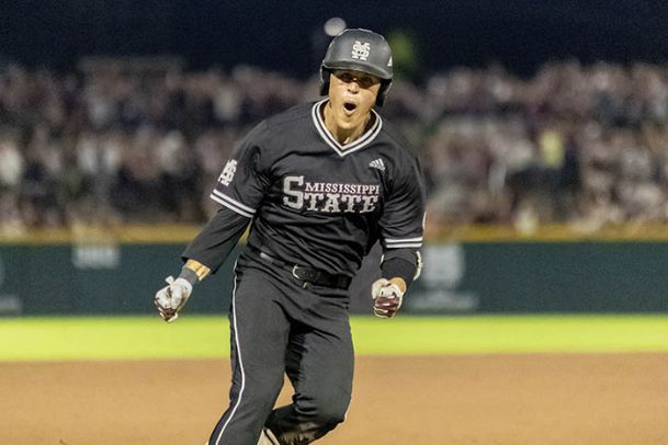 Mississippi State senior Elijah MacNamee celebrates Sunday as he rounds the bases after hitting a home run at Dudy Noble Field.