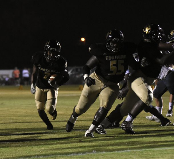 New Hope offensive lineman Jeremiah Jefferson (55) leads the way for wide receiver Malachi Clay (2) on a touchdown run Friday in New Hope.