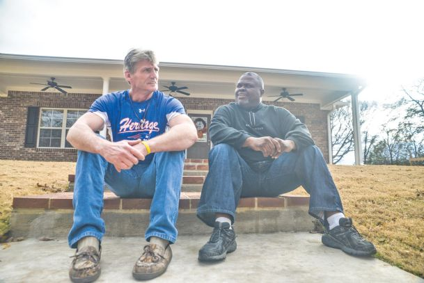 Last House on the Block resident Keith Stacy, left, sits in front of the new recovery house in Columbus on Saturday with house manager, Billy Jordan.