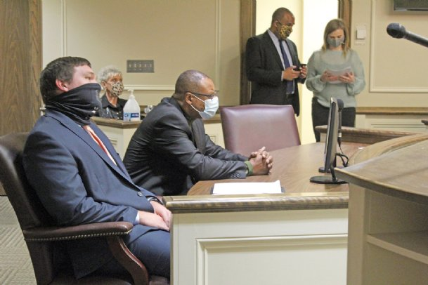 Former Columbus Chief Financial Officer Milton Rawle, right, sits alongside his attorney, Daniel Waide of Hattiesburg, and awaits the start of his plea and sentencing hearing at Lowndes County Courthouse Monday. Rawle was sentenced to 20 years in Mississippi Department of Corrections after he pleaded guilty to embezzling nearly $290,000 in city funds between December 2016 and December 2018.