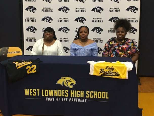 Takara Givens, center, signed her letter of intent to play softball at Mississippi Valley State on Wednesday. Givens, a senior this spring, only got to play one game for the Panthers before the coronavirus pandemic ended the season.