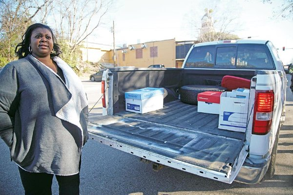 Tiffany Ramsey, a teacher with the Noxubee County School District, drove her truck to pick up school supplies for her students at the Trotter Convention Center in Columbus Monday morning.