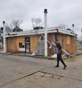 Sammie Lee removes debris shortly after the Feb. 23, 2019, tornado that badly damaged his gas station/convenience store on Waterworks Road. Lee said he agonized over the decision of what to do with the property but ultimately chose to rebuild it to serve as