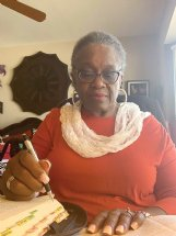 Jackie Richardson of Columbus follows along in the Bible study guide