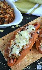 Savory caramelized onions and melted Gruyere cheese on French onion hot dogs bring the essence of French onion soup to a summertime occasion.