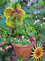 Accessories can add character or create mood in the garden. Don't be afraid to color outside the lines.