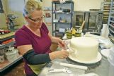 Nicole Huff designs a wedding cake in the back room of Southern Flour Bakery, the bakery she owns on Highway 45 North in Columbus. Huff has said she has no plans to  change her business practices or turn away same-sex couples when House Bill 1523 goes into effect.