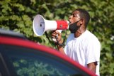 Jermaine Shanklin shouts into a megaphone on Monday during a county supervisors meeting outside the Lowndes County Courthouse in Columbus.