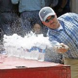 Mitch Cargile of Columbus slices through a row of water bottles at a cutting competition in Arkansas in 2018. He used a knife he forged himself — and named Sir Chops A Lot. Cargile, who lives in the New Hope community, was one of four smiths competing in the Jan. 15 episode of the show