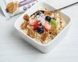 Fruits and almonds help change plain Greek yogurt into a delicious yogurt parfait.