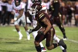 Mississippi State's Deddrick Thomas (2) runs with the ball during the Egg Bowl Thursday in Starkville.