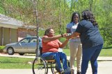 Starkville resident Saqueena Graves, left, receives a plate of food from SaPerior Patton, right.