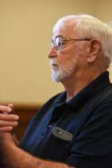 District 1 Supervisor Harry Sanders listens as Bishop Scott Volland asks the county to consider removing a Confederate monument from the courthouse lawn during a board of supervisors meeting on Monday. Sanders proposed that instead of relocating the statue, they compromise by adding onto the monument to address slavery. Later, Volland said that what Sanders didn't realize is that relocating the statue already was compromising.
