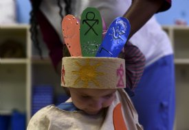 Marlee Cate Hudson, daughter of Robby and Anna Hudson, wears a colorful Native American-inspired headdress for dress rehearsal Nov. 20 at First United Methodist Church Early Learning Center in Columbus. / Photo by: Jennifer Mosbrucker/Dispatch Staff
