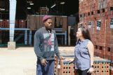 Brick grader German Smith and Human Resources manager Lucy Anne Walker discuss work at Columbus Brick on Monday. Smith has served two prison sentences for separate charges but has continued to work at Columbus Brick. Walker said Columbus Brick, while cautious about hires, has always believed people should be given second and third chances and is open to hiring employees with a criminal record.