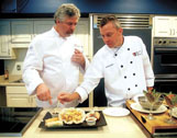 Chef Greg Beachey of Chicago, left, and Chef Grady Griffin of Jackson evaluate appetizers created by participants in the ProStart Institute at Mississippi University for Women. Beachey is the ProStart national program director. Griffin is director of education for the Mississippi Hospitality Restaurant Association.