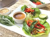 Thai chicken lettuce wraps with peanut sauce incorporate the protein of peanuts and make a memorable presentation.