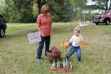 Three-year-old Katherine Bassett of Starkville plays Pumpkin Ring Toss at the Oktoc Country Store as her grandmother, Suzanne Tribble of Starkville, looks on.