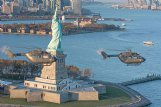 Two UH-72 Lakota helicopters fly near the Statute of Liberty. Airbus will produce 15 of these light utility helicopters for the U.S. Army.