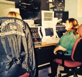 Jacque Brown, right, sits at the old switchboard at Lowndes County E911 in the early 90s when she first became a dispatcher for area law enforcement. Brown has worked as a dispatcher on and off for more than 20 years, and has seen many technical changes to how dispatchers work in that time.