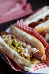 Flavorful corn salsa and a sour cream drizzle dress up these hot dogs.