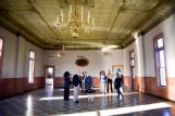 Visitors admire the second-floor ballroom of the Elks Lodge during a Mississippi Heritage Trust tour Friday.
