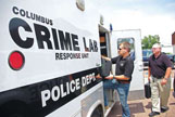 Austin Shepherd, left, and Andy McCants, of the Columbus Forensic Lab, load the response-unit vehicle with equipment, Wednesday. Columbus' crime lab is he first in the state to add technology allowing it to create antibody profiles.