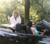 Tammy Prescott, right, drives a rented convertible with her friend Karen Cooley, during a trip to the Mississippi coast earlier this month. Prescott, a community volunteer and lieutenant with Lowndes County Sheriff's Office, died Friday from cancer.