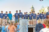 Members of the Heritage Academy state championship boys basketball team take to center stage during Tuesday's celebration event in downtown Columbus.