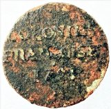 A 1721 French copper coin found on the beach at Dauphin Island, Alabama, after a storm. It is a 9 deniers coin minted for circulation in the French colonies of Canada and Louisiana. Barely readable is the legend on the reverse