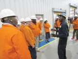 Steel Dynamics Columbus paint supervisor Anthony Mabins explains the operations of SDI's paint line to Lowndes County supervisors during a tour of the facility Thursday. The $94 million paint line, which has been in operation for two years, has allowed the company to diversify its product line.