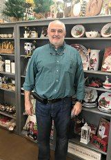 """Alan Senter stands in front of a shelf at Senter's Hardware & Gifts, a downtown Macon store his family has owned for 107 years. For this year's shopping season, Senter said he expects a fair-sized crowd. """"(People) have been working on home projects, and then you have the government stimulus (checks), which a lot of people spent,"""" he said."""