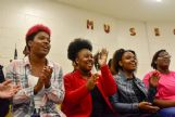 Choir members break out into a uptempo piece Wednesday. From left are Jamiya Smith, 17, the daughter of Alexis and Pennie Smith; Tanya Thomas, 16, daughter of Keisha Thomas; Britney Hill, 16, daughter of Frances Ellis; and Anijha Harris, 17, daughter of Ighanda Harris.