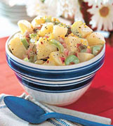 State Fair potato salad calls for a drizzle of sweet pickle juice on warm potatoes.