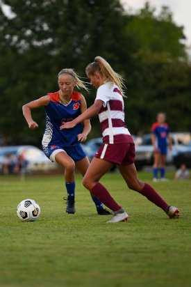 Starkville Academy Junior Mia Kate Cade vies for the ball during a soccer game against Hartfield Academy on Tuesday in Starkville. / Photo by: Claire Hassler/Dispatch Staff