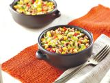See the recipe for this black-eyed pea, corn and rice salad in today's food pages. Adding more vegetables or fruits is one of the simplest ways to make at-home meals healthier for your family.