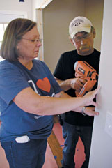 """Brenda and Audie Pettit apply some """"sweat equity� Tuesday to the  house their son, Trey Warrington,  will soon  move into."""