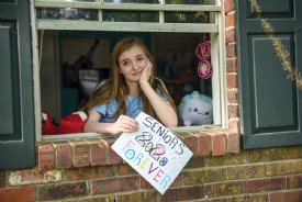 Lily Dunn, 17, sits in her bedroom during the COVID-19 quarantine. She is a senior at New Hope High School.