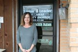 Stephanie Minor stands outside the Lamar Leader office on Highway 17 in Sulligent Friday. As the newspaper's new owner, she hopes to increase its online presence and add human interest stories that will help keep the small weekly viable in the town of 1,800 residents.