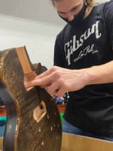 Rain Sesser, 16, does some sanding on the body of his guitar in progress Wednesday at The Idea Shop. Rain is a junior at Starkville High and is the son of Brandon and Amy Sesser of Starkville.