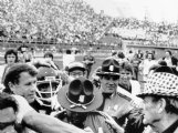 Mississippi State coach Emory Bellard, left, and Alabama coach Paul 'Bear' Bryant, far right, meet at midfield after the Bulldogs toppled the Tide 6-3 on Nov. 1, 1980, at Mississippi Veterans Memorial Stadium in Jackson.