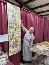 Julia Graber of Brooksville shows her quilt,