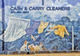 Pictured above is a mural on the side of West Point's Cash & Carry Cleaners. Mural designer Deborah Mansfield said she began painting these murals because she thought the town needed 'a fresh coat of paint.'